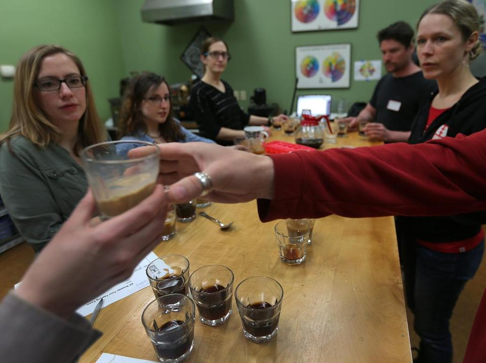 Equal Exchange workers tested out coffee blends earlier this month in the tasting room at the company's West Bridgewater facility.